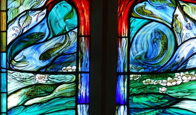 Four Seasons window by contemporary glass artist Jude Tarrant glass painter